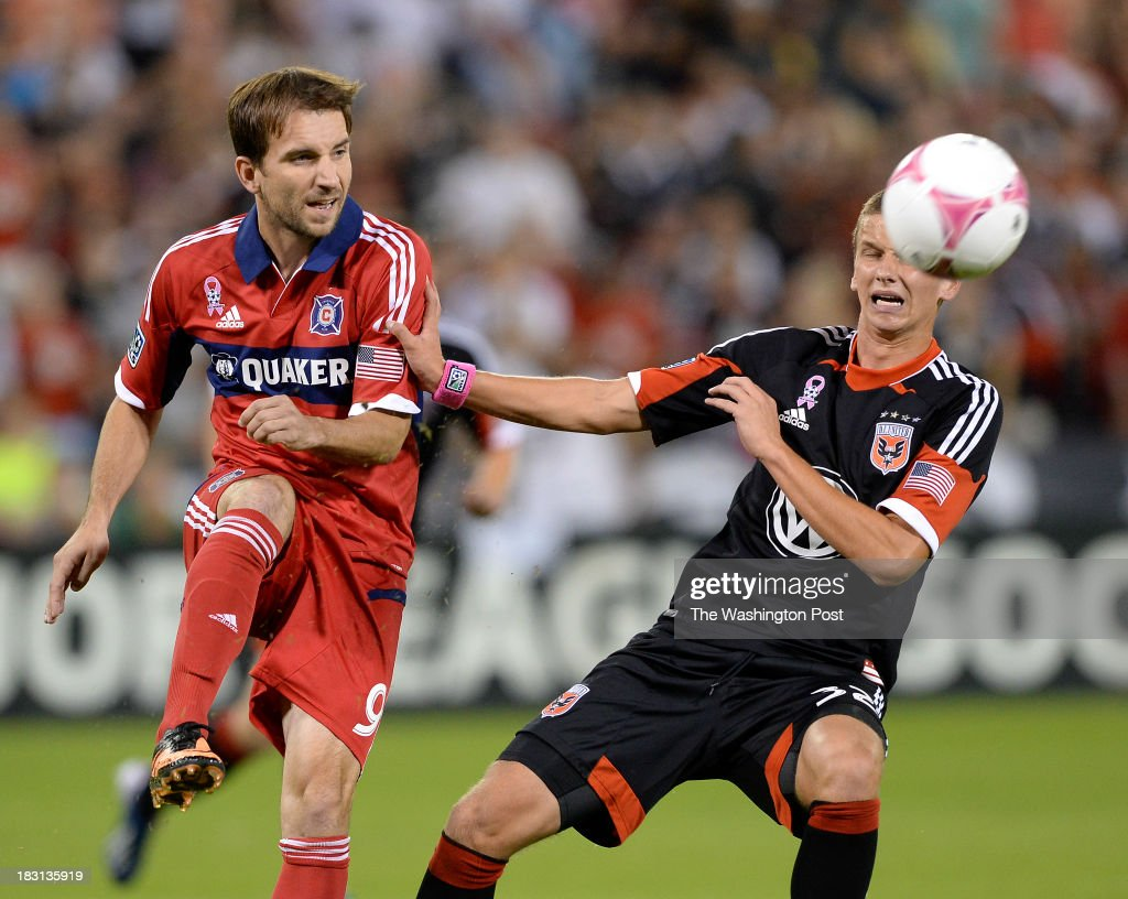 Chicago Fire forward Mike Magee clears the ball away from DC United midfielder Collin Martin during the first half of the game between the DC United...