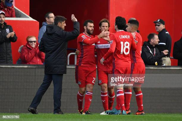 Chicago Fire forward Nemanja Nikolic celebrates his goal with teammates and Chicago Fire head coach Veljko Paunovic during a game between the...