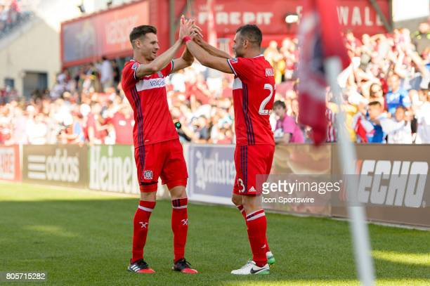 Chicago Fire forward Nemanja Nikolic celebrates his second goal with Chicago Fire forward Luis Solignac in the first half during an MLS soccer match...