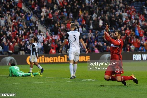 Chicago Fire forward Nemanja Nikolic slides to celebrate his hattrick during a game against the Philadelphia Union and the Chicago Fire on October 15...