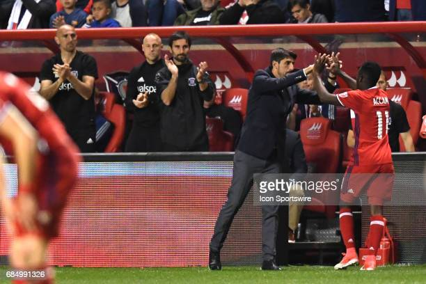 Chicago Fire head coach Veljko Paunovic congratulates Chicago Fire forward David Accam during a game against the Seattle Sounders and the Chicago...