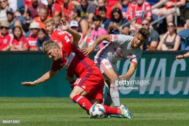 Chicago Fire midfielder Bastian Schweinsteiger and Atlanta United FC forward Hector Villalba collide in the first half during an MLS soccer match...
