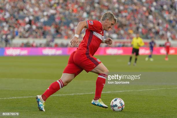 Chicago Fire midfielder Bastian Schweinsteiger dribbles the ball in the first half during an MLS soccer match between Orlando City FC and the Chicago...