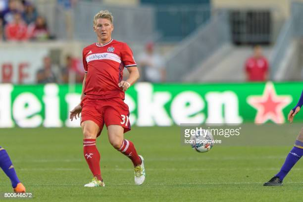 Chicago Fire midfielder Bastian Schweinsteiger passes the ball in the first half during an MLS soccer match between Orlando City FC and the Chicago...