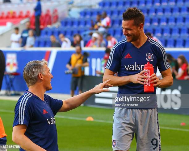 Chicago Fire midfielder Bastian Schweinsteiger talks with teammate Chicago Fire forward Luis Solignac prior to the Major League Soccer game between...