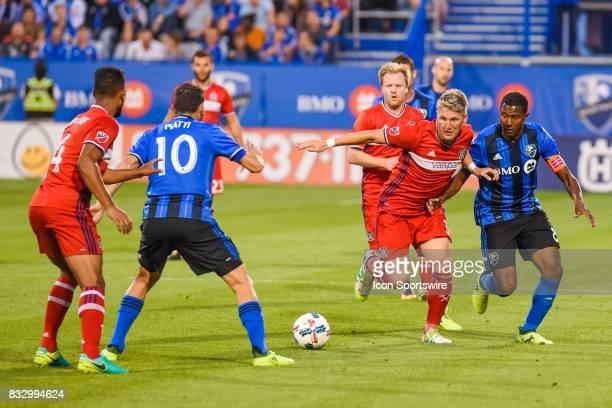 Chicago Fire midfielder Bastian Schweinsteiger trying to stop a pass between Montreal Impact midfielder Patrice Bernier and Montreal Impact...