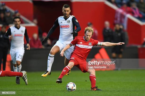 Chicago Fire midfielder Dax McCarty controls the ball against Philadelphia Union midfielder Ilsinho during a game between the Philadelphia Union and...