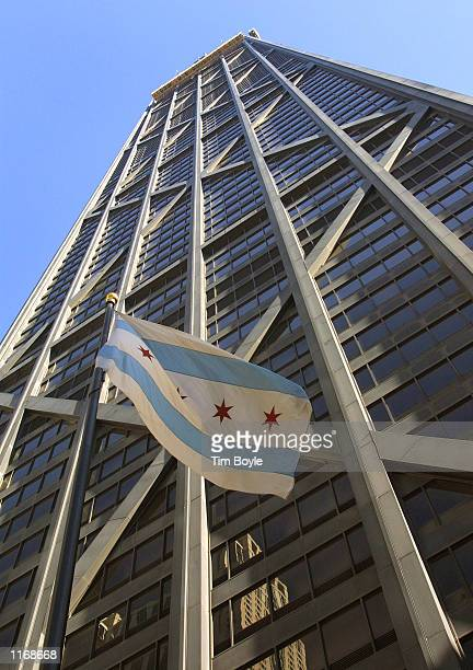 Chicago flag flies in front of the west facade of the John Hancock Building October 17 2001 in Chicago City workers recently placed concrete barriers...