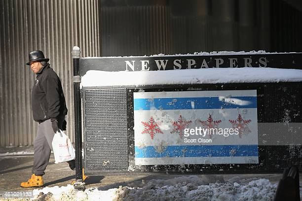 Chicago flag with snowflakes instead of stars is displayed on the back of a newspaper vending box as temperatures dipped well below zero in the Loop...
