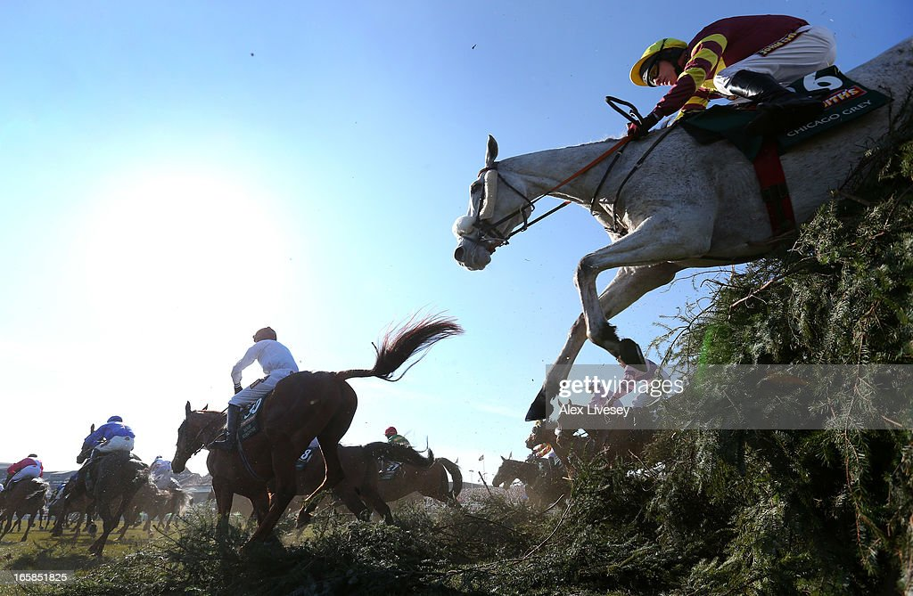 Chicago Grey ridden by <a gi-track='captionPersonalityLinkClicked' href=/galleries/search?phrase=Paul+Carberry&family=editorial&specificpeople=171766 ng-click='$event.stopPropagation()'>Paul Carberry</a> jumps The Chair during the John Smiths Grand National at Aintree Racecourse on April 6, 2013 in Liverpool, England.