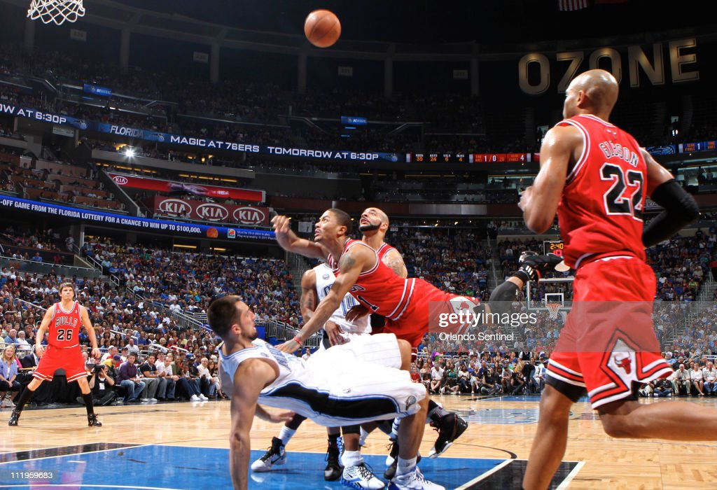 Chicago guard Derrick Rose (1) runs over Orlando forward Ryan Anderson (33), drawing the foul, during the Bulls' 102-99 victory over the Magic at Amway Center in Orlando, Florida, Sunday, April 10, 2011.