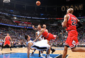 Chicago guard Derrick Rose runs over Orlando forward Ryan Anderson drawing the foul during the Bulls' 10299 victory over the Magic at Amway Center in...