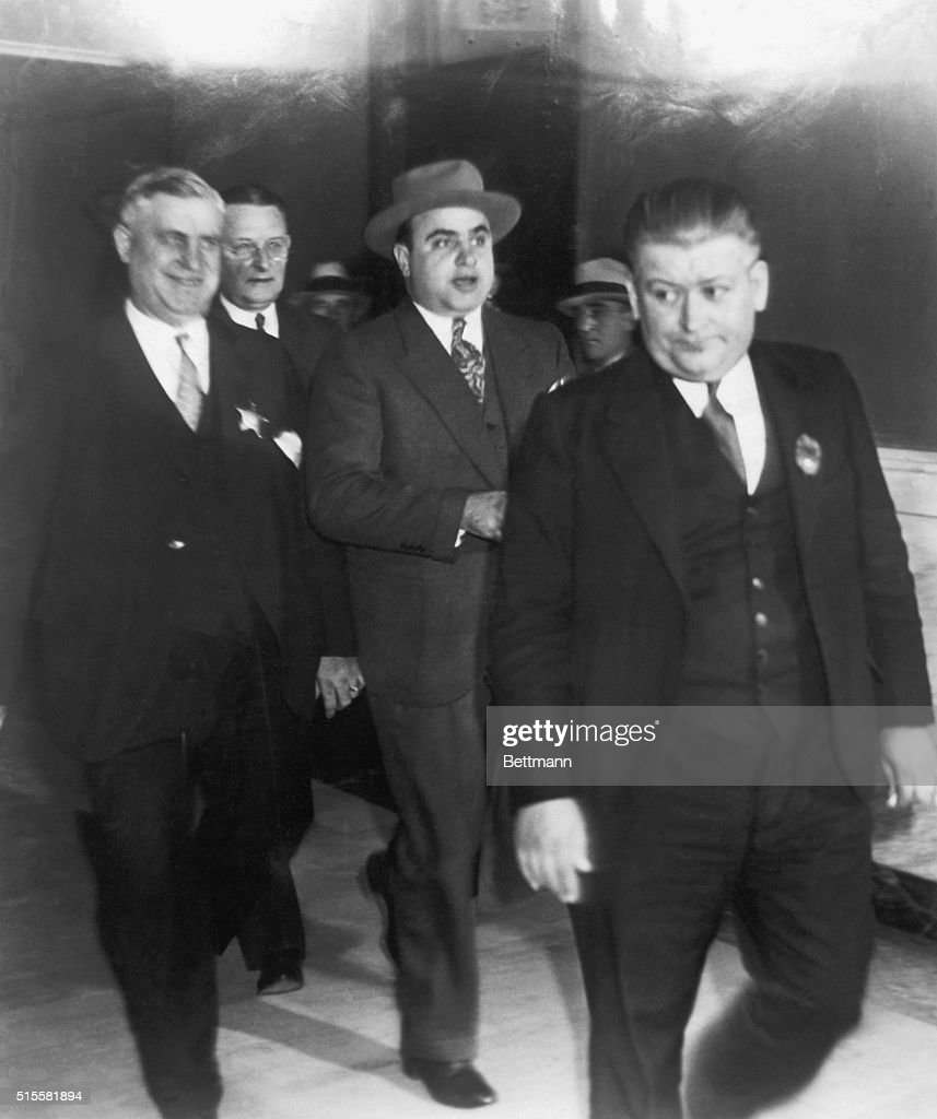 <a gi-track='captionPersonalityLinkClicked' href=/galleries/search?phrase=Al+Capone&family=editorial&specificpeople=93051 ng-click='$event.stopPropagation()'>Al Capone</a>, Chicago gang leader, being led from Chicago Federal Court after receiving sentence for income tax evasion.