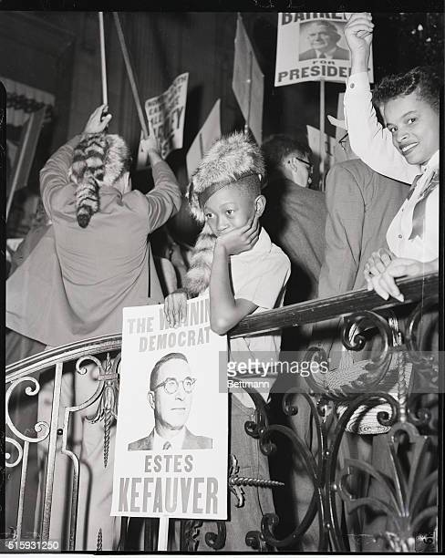 7/21/1952 Chicago IL Cooledoffcoonskin As a hectic political rally swirls about him this young Kefauver demonstrator loses enthusaism as his energy...