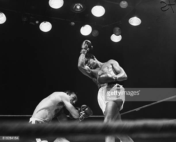 Photo shows Sugar ray Robinson vs Carmen Basilio in boxing action in the middle weight title bout Robinson had a body temperature of 103 degrees...