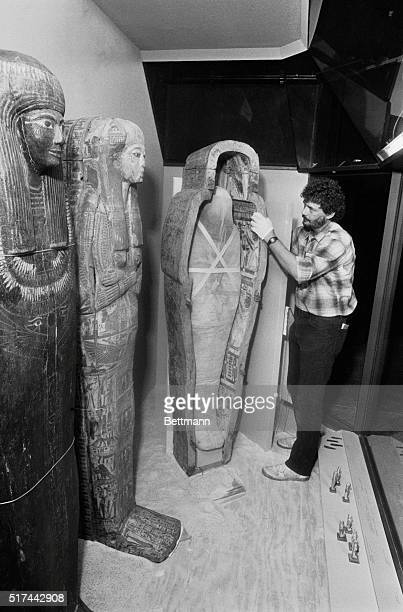 Installer Larry Degand adjusts mummies at the exhibit which features over 1 400 rare artifacts and priceless treasures from the Field Museum's...