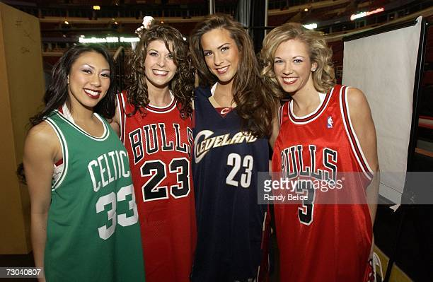 Chicago LuvaBulls dance team members Erika Sara Shannon and Erin model autographed jerseys prior to the start of a live auction during the 18th...