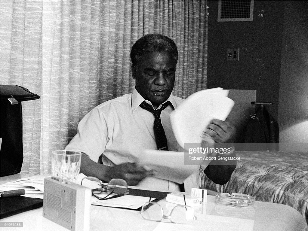 Chicago mayor Harold Washington (1922 - 1987) looks over some paperwork during the 1984 Democratic National Convention, California, 1984.