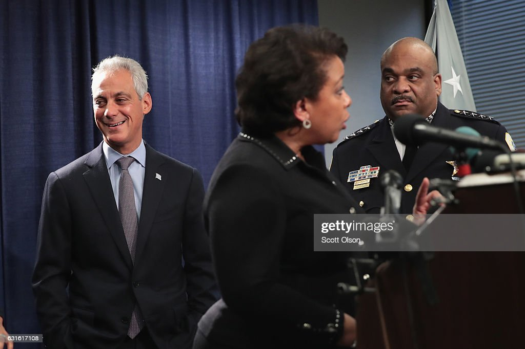 Chicago Mayor Rahm Emanuel (R) and Police Superintendent Eddie Johnson (L) listen as U.S. Attorney General Loretta Lynch speaks at a press conference on January 13, 2017 in Chicago, Illinois. Lynch called the press conference to announce the release of a report which cited widespread abuses by officers in the Chicago police department following a 13-month investigation.