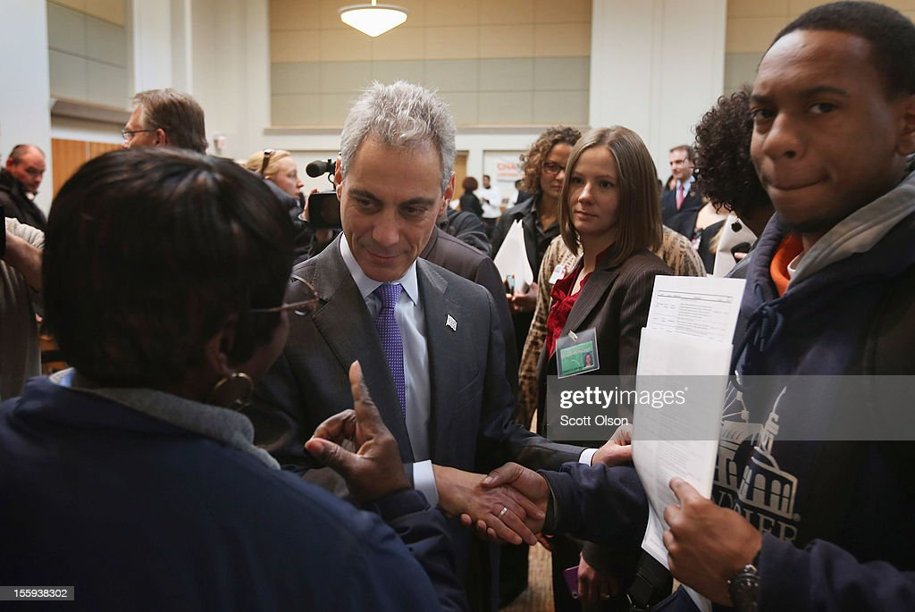 Chicago Mayor Rahm Emanuel greets job seekers during a job fair hosted by the city of Chicago on November 9, 2012 in Chicago, Illinois. Thousands of people waited in line beginning at 3AM for the job fair which did not open the doors until 9AM. When the doors opened the line was about a half-mile long.