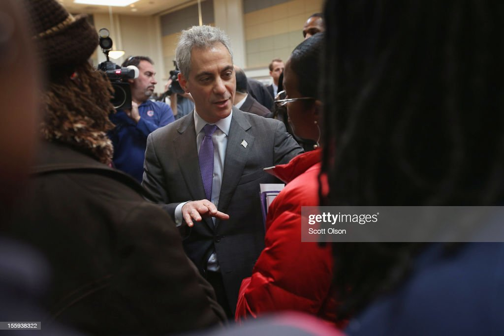 Chicago Mayor <a gi-track='captionPersonalityLinkClicked' href=/galleries/search?phrase=Rahm+Emanuel&family=editorial&specificpeople=753774 ng-click='$event.stopPropagation()'>Rahm Emanuel</a> greets job seekers during a job fair hosted by the city of Chicago on November 9, 2012 in Chicago, Illinois. Thousands of people waited in line beginning at 3AM for the job fair which did not open the doors until 9AM. When the doors opened the line was about a half-mile long.