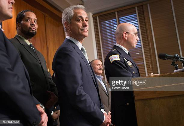 Chicago Mayor Rahm Emanuel listens as Interim Chicago Police Superintendent John Escalante addresses changes in training and procedures that will...