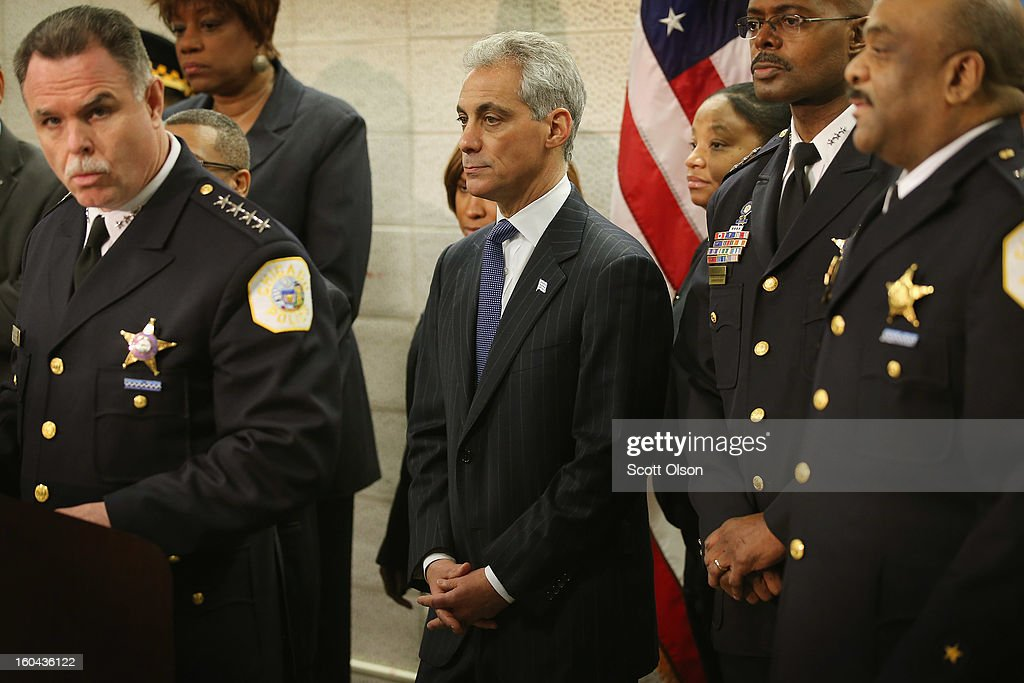 Chicago Mayor Rahm Emanuel (C) listens as Police Superintendant Garry McCarthy (L) discusses a plan to reassign 200 police officers from administrative duties back to patrol duties during a press conference on January 31, 2013 in Chicago, Illinois. Chicago has been faced with a rising murder rate largely attributed to an increase in gang related violence. Last year the city had more than 500 murders. The city has had more than 40 murders in January 2013, surpassing the total for January 2012.