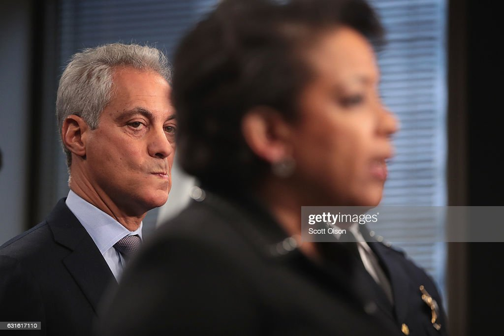 Chicago Mayor Rahm Emanuel (L) listens as U.S. Attorney General Loretta Lynch speaks at a press conference on January 13, 2017 in Chicago, Illinois. Lynch called the press conference to announce the release of a report which cited widespread abuses by officers in the Chicago police department following a 13-month investigation.