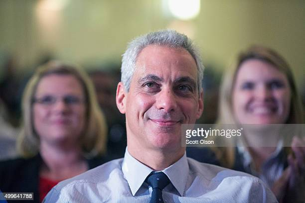 Chicago mayor Rahm Emanuel listens to speakers at Wendell Phillips Academy High School during a gathering to celebrate the schools state 4A football...