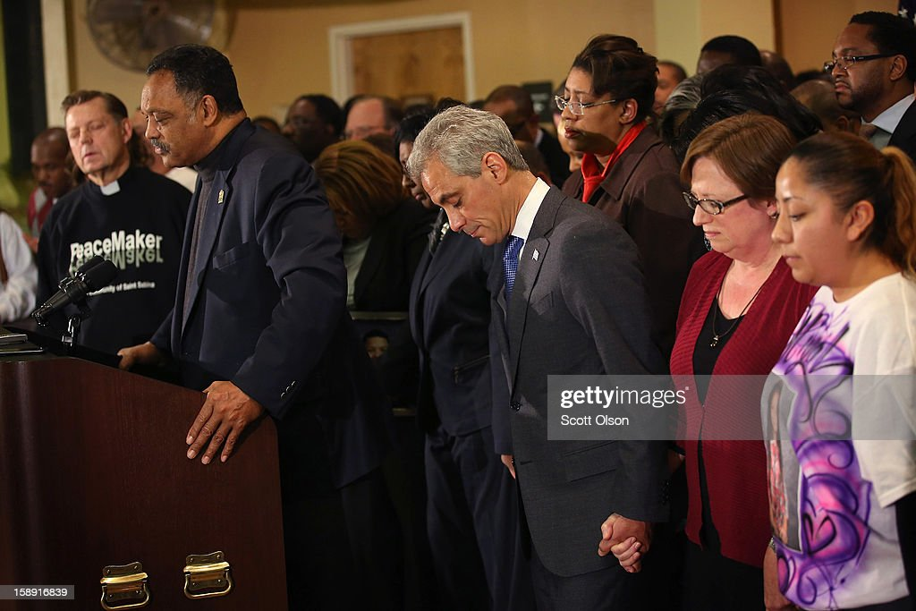 Chicago Mayor Rahm Emanuel (C) stands with family members of murder victims and community leaders as he listens to a prayer by the Rev. Jesse Jackson (L) during a press conference at St. Sabina Church January 3, 2013 in Chicago, Illinois. The press conference was held to make a plea for stronger gun regulations including a ban on assault weapons. In 2012 Chicago reported 506 murders. In the first 3 days of 2013 Chicago has had 5 murders.