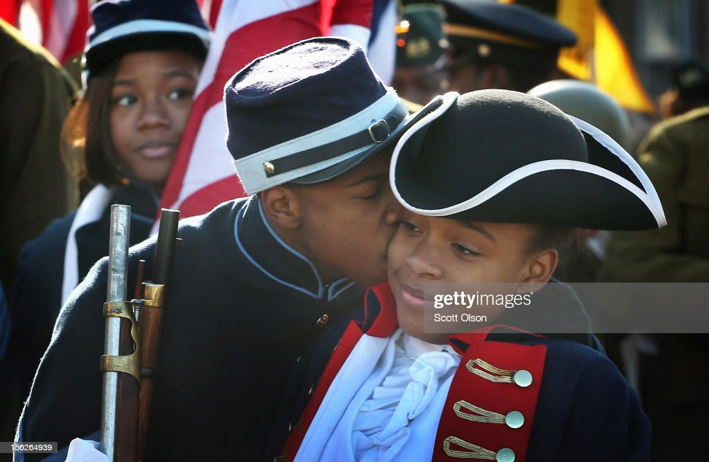 Chicago Military Academy student Jeffrey Carodine kisses the cheek of fellow student Iyana Quinn before they step off in the Chicago Veterans Day parade on November 12, 2012 in Chicago, Illinois. Veterans Day, held the anniversary of the signing of the armistice which ended the World War I, is celebrated to honor all veterans for their service.