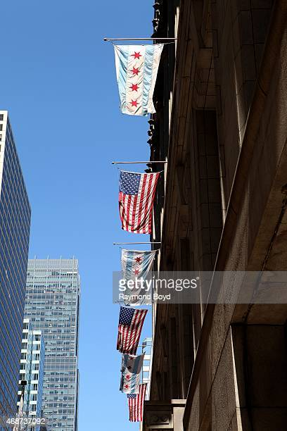 Chicago Municipal flags and American flags flies outside City Hall on April 4 2015 in Chicago Illinois