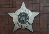 Chicago police badge hangs in front of the City of Chicago Public Safety Headquarters on December 1 2015 in Chicago Illinois Following public outcry...