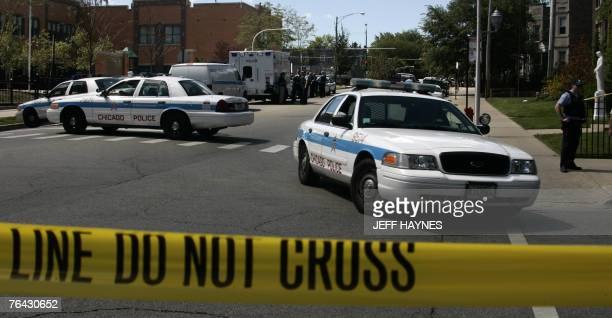 Chicago police block a street during a standoff with a bank robber 30 August 2007 Police searched the bank in Chicago's North Side where a gunman...
