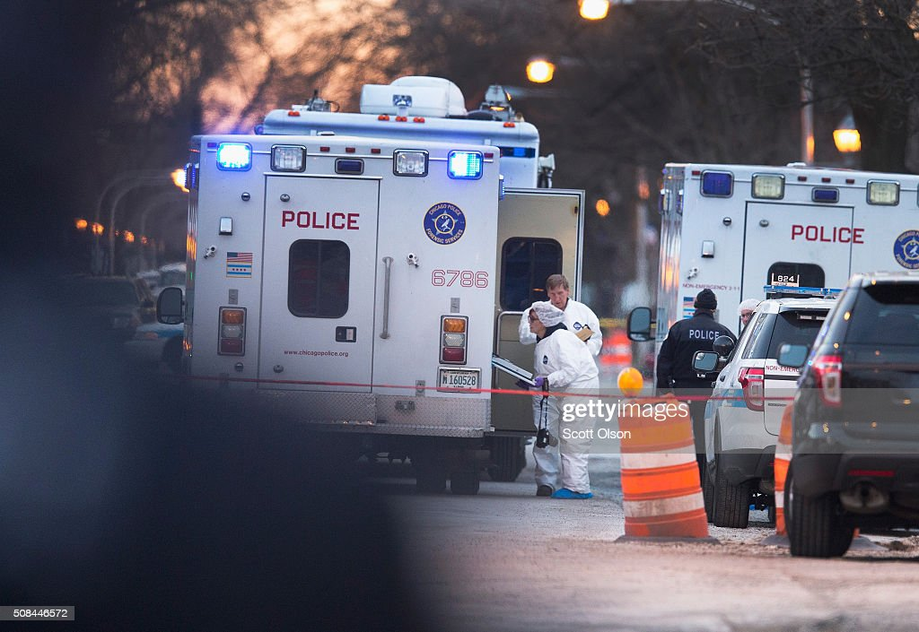 Chicago police collect evidence at a home where six people were found slain on the city's Southwest Side on February 4 2016 in Chicago Illinois Last...
