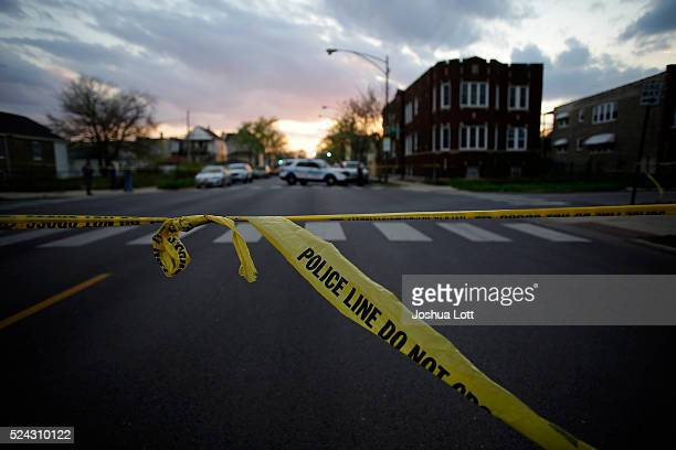 Chicago Police crime tape is displayed at the scene where a 16yearold boy was shot in the head and killed and another 18yearold man was shot and...