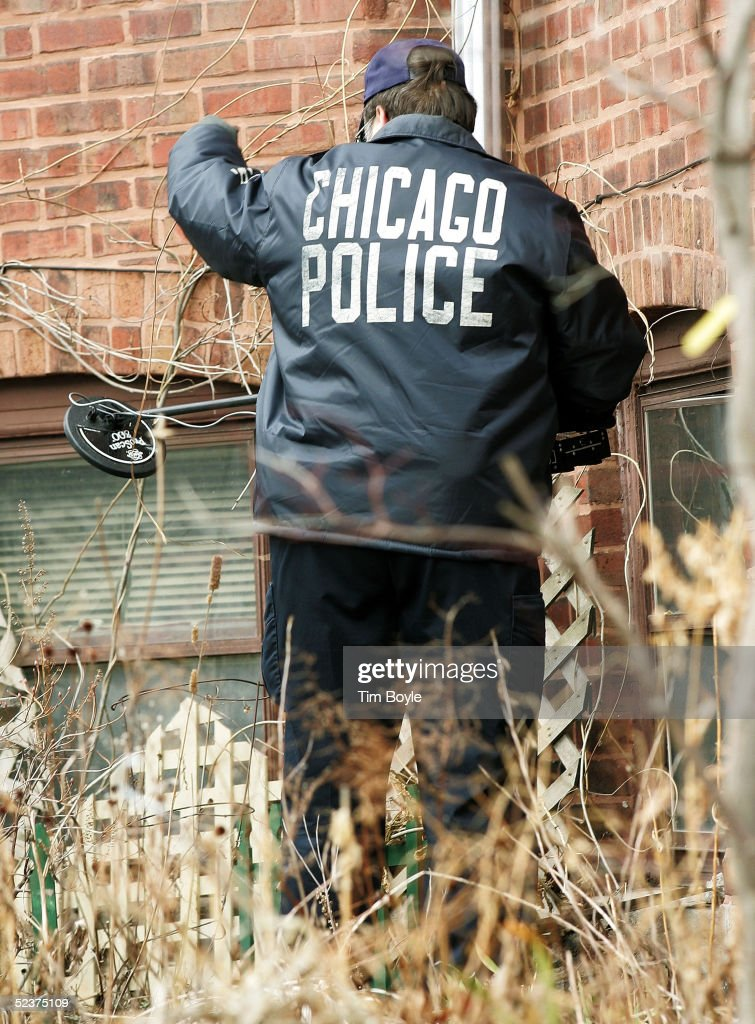 A Chicago Police department investigator works near the home of U.S. District Judge Joan Lefkow March 11, 2005 in Chicago, Illinois. Lefkow's husband Michael Lefkow and mother, Donna Humphrey, were murdered February 28 in the Lefkow home. Investigators have found a DNA match found on a cigarette butt at the crime scene linking a Chicago man, Bart Ross, to the double murder. Ross, who allegedly claimed responsibility for the crime via numerous notes, committed suicide in West Allis, Wisconsin March 9.