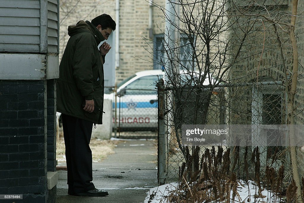 A Chicago Police department investigator works near the home of US District Judge Joan Lefkow March 11, 2005 in Chicago, Illinois. Lefkow's husband Michael Lefkow and mother, Donna Humphrey, were murdered February 28 in the Lefkow?s home. Investigators have a DNA match found on a cigarette butt at the crime scene linking a Chicago citizen Bart Ross to the double murder. Ross, who allegedly claimed responsibility for the crime via numerous notes, committed suicide in West Allis, Wisconsin on March 9.