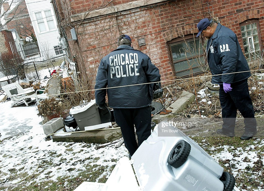 Chicago Police department investigators work near the home of US District Judge Joan Lefkow March 11, 2005 in Chicago, Illinois. Lefkow's husband Michael Lefkow and mother, Donna Humphrey, were murdered February 28 in the Lefkow?s home. Investigators have a DNA match found on a cigarette butt at the crime scene linking a Chicago citizen Bart Ross to the double murder. Ross, who allegedly claimed responsibility for the crime via numerous notes, committed suicide in West Allis, Wisconsin on March 9.