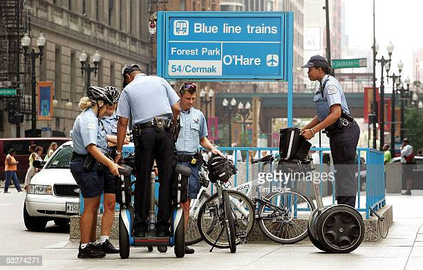 Chicago police department presence is seen near an entrance to a CTA subway line July 22 2005 in downtown Chicago Illinois The public mass transit...