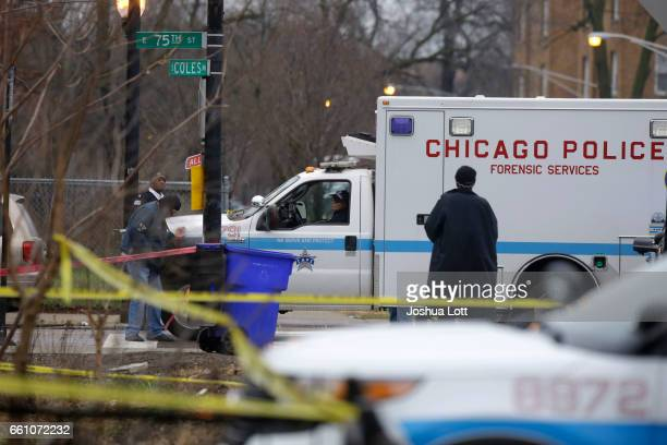 Chicago Police forensic service vehicle arrives at the scene where four people were shot and killed at a restaurant in the 2700 block of East 75th...