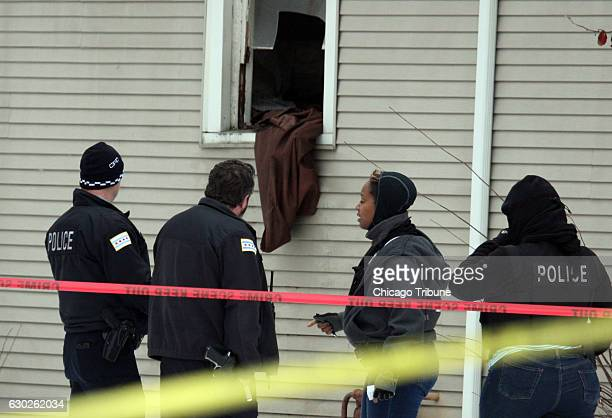 Chicago police investigate a multiple shooting at a home in the 100 block of West 105th Street on Dec 17 where two women ages 19 and 41 and men ages...