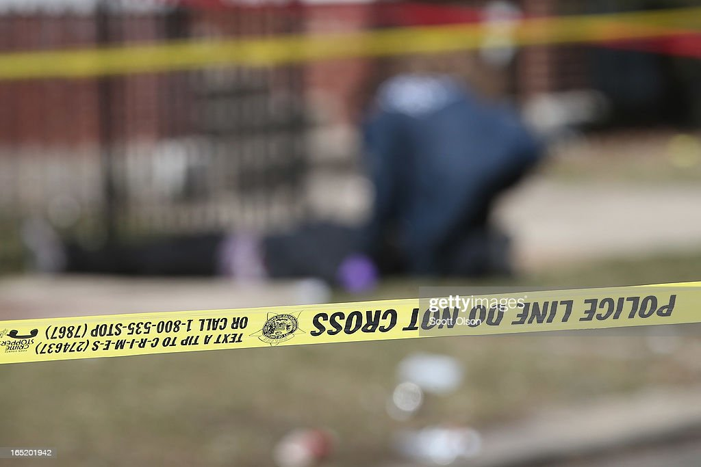 Chicago police investigate the murder of a 24yearold man who was shot and killed on South Eberhart Avenue on the city's South Side April 1 2013 in...