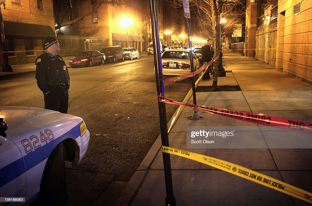 Chicago police investigate the scene where two men were shot in the Old Town neighborhood on January 8, 2013 in Chicago, Illinois. Tyshawn Blanton, 31, died as a result of the shooting and a 20-year-old man who was shot in the back was taken to the hospital in serious-to-critical condition. Blanton's murder was at least the 14th murder in the city this year. The Old Town neighborhood was selected last month by Realtor.com as 2012's hottest neighborhood in the country. Today Vice President Joe Biden will be meeting with victims' groups and gun-safety organizations at the White House in his effort to develop proposals to curb gun violence following the Sandy Hook school shooting in Newtown, Connecticut. Tomorrow he is expected to meet with the NRA.
