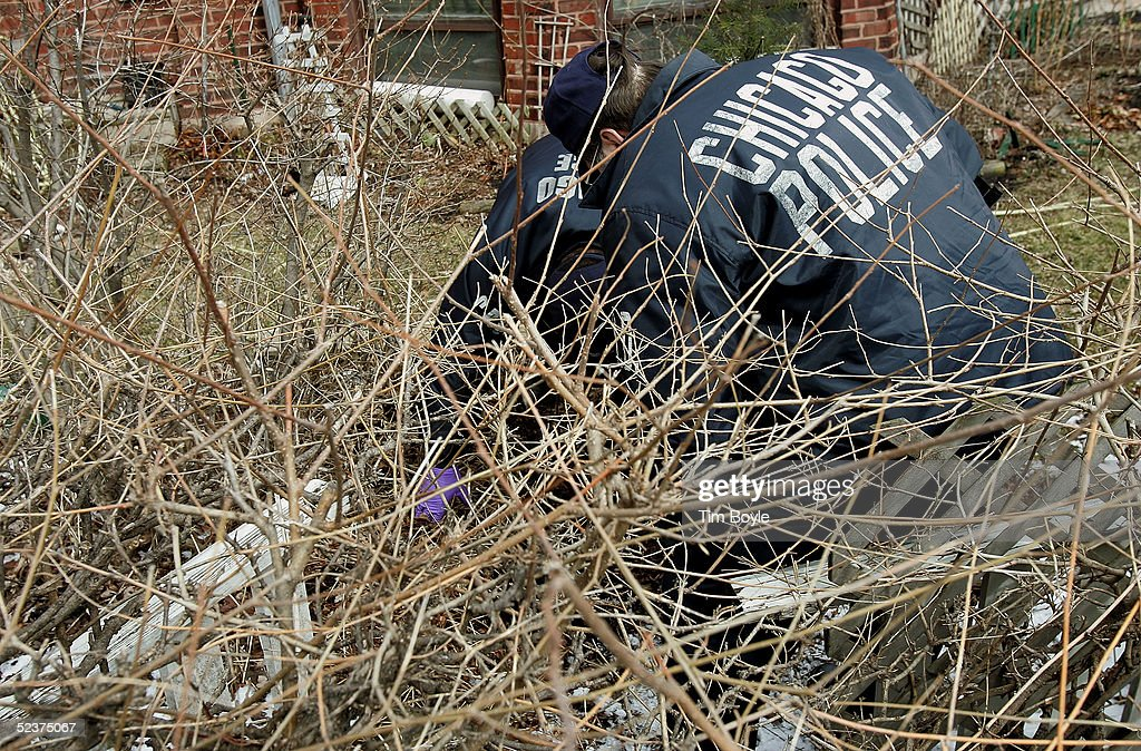 Chicago Police investigators work near the home of U.S. District Judge Joan Lefkow March 11, 2005 in Chicago, Illinois. Lefkow's husband Michael Lefkow and mother, Donna Humphrey, were murdered February 28 in the Lefkow home. Investigators have found a DNA match found on a cigarette butt at the crime scene linking a Chicago man, Bart Ross, to the double murder. Ross, who allegedly claimed responsibility for the crime via numerous notes, committed suicide in West Allis, Wisconsin March 9.
