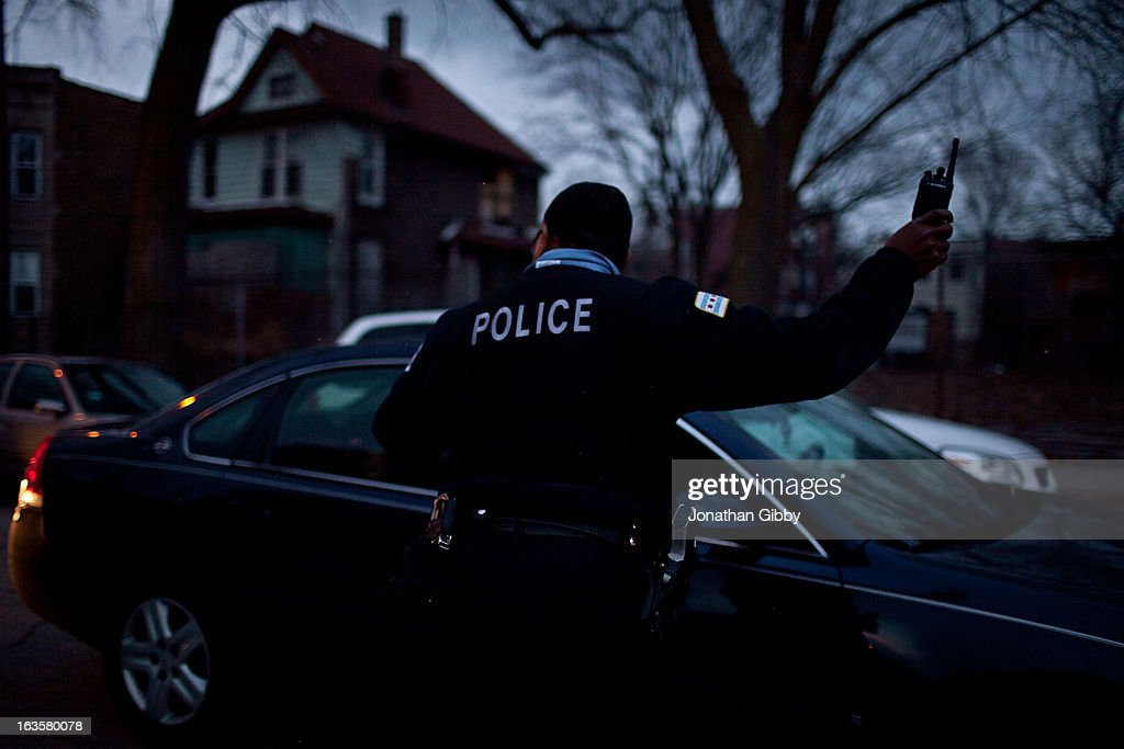 A Chicago police officer directs traffic during a vigil for slain infant Jonylah Watkins on March 12, 2013 in Chicago, Illinois. The 6-month-old girl was shot five times on the 6500 block of South Maryland Avenue while her father was changing her diaper in the passenger seat of his car. The father, Jonathan Watkins remains is stable condition at Nothwestern Memorial Hospital after receiving three gunshot wounds.