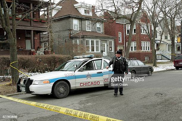 Chicago Police officer guards home where Michael Lefkow and Donna Humphrey the husband and mother of United States District Judge Joan Lefkow were...