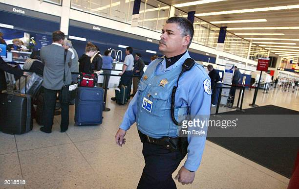 Chicago Police officer Patrick Ganshirt patrols Terminal 3 at Chicago's O'Hare International Airport on May 21 2003 in Chicago Illinois The airport...