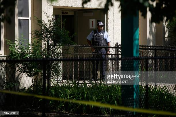 A Chicago Police officer stands outside Warren Elementary School where two girls 7 and 13 were shot during a school picnic on June 16 in Chicago...