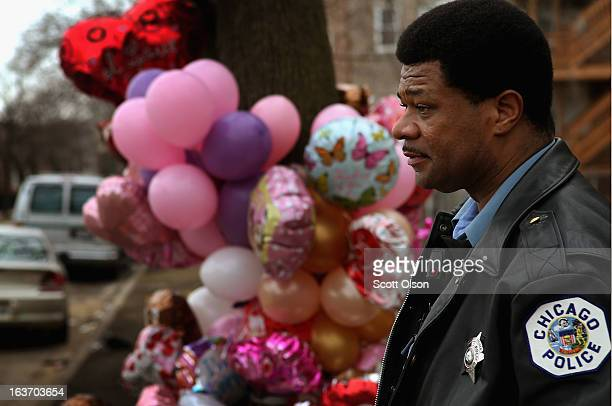 Chicago police officer Tracy Quarles looks over a memorial for 6monthold Jonylah Watkins on March 14 2013 in Chicago Illinois Jonylah's father...